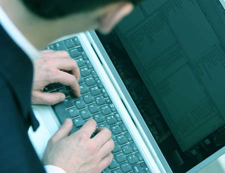 business man with his laptop typing away Stock Photo