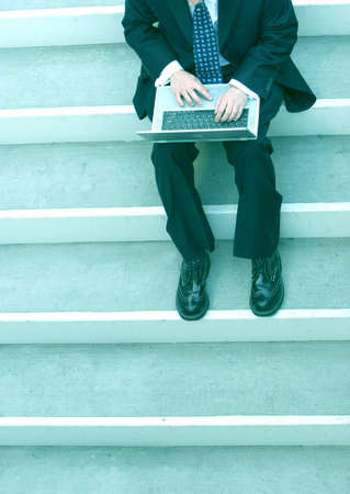 business man sitting and working