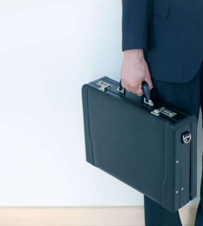 holding the briefcase