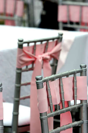 chairs with pink ribbons