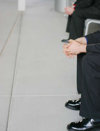 two business men sitting on benches Stock Photo