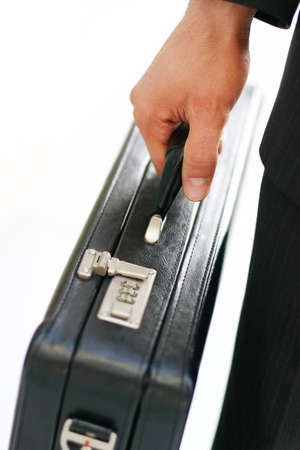 Business man holds onto his briefcase Stock Photo