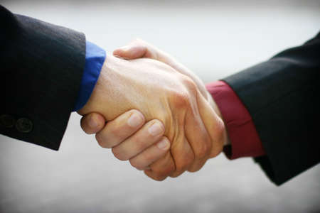 business men shaking their hands after the deal