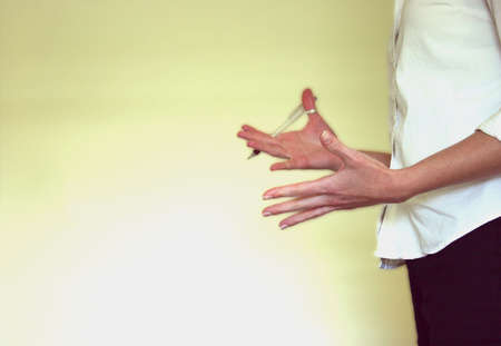 woman speaking with her hands in a meeting Stock Photo