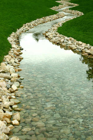 fresh water way with stream and rocks Stock Photo