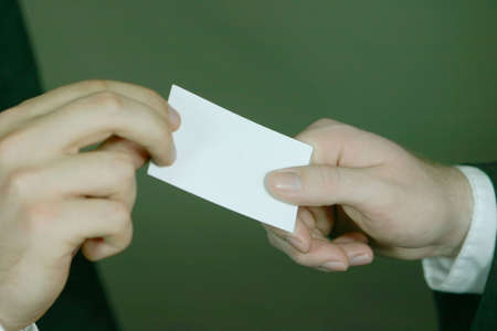 Business men exchange their business card