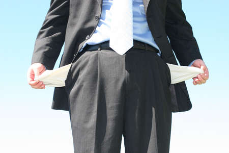 Business man stands with his pockets empty Stock Photo - 267334
