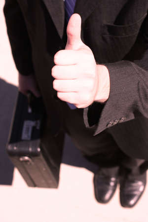 Business man stand with thumb in the air