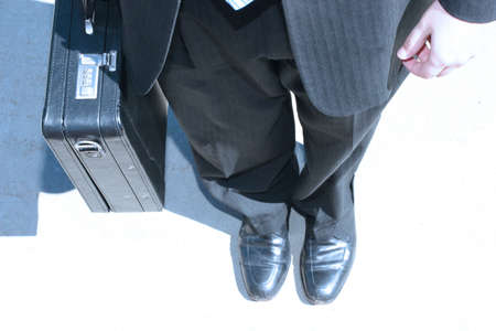 Business man stands alone Stock Photo