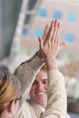 Business man and woman give each other a high-five