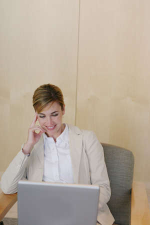 Business woman works on her laptop at the office