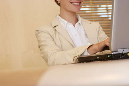 Business woman sits and works in the office on her laptop Stock Photo