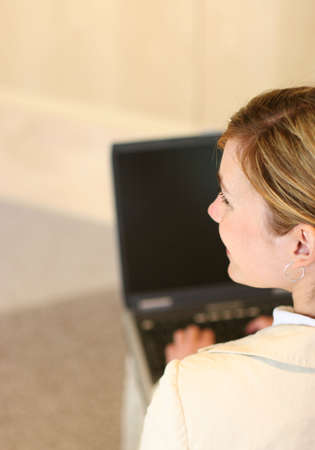 Business woman works on her laptop Stock Photo