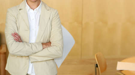 Business woman stands with her arms folded Stock Photo