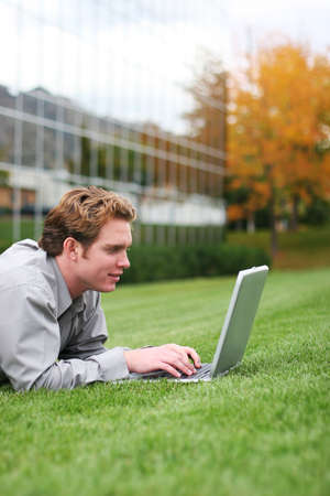 business man works outside of his office in the green grass Stock Photo