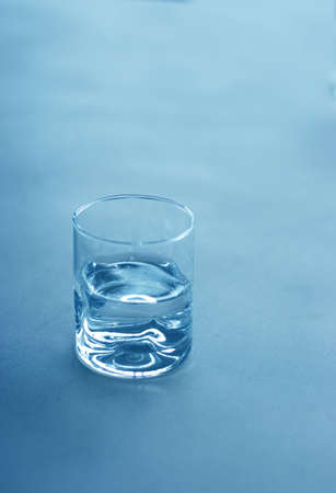 Glass of water sits on a table