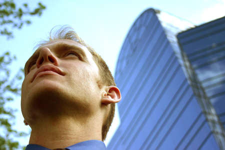 Business man looking up and ahead Stock Photo