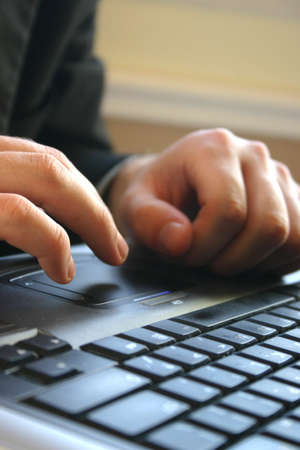 Business man typing on his keyboard