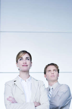 Business man and woman looking foward