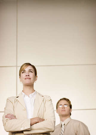 Business woman and man standing strong Stock Photo
