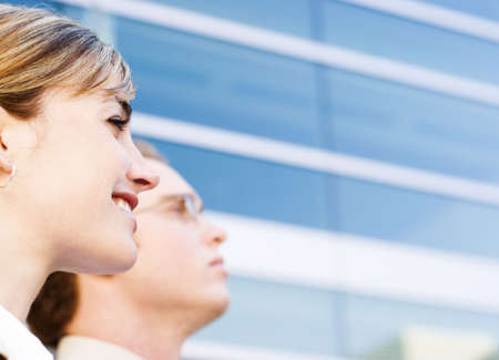 Business man and woman standing in front of business building Stock Photo