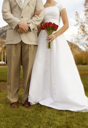 Bride and groom holding arms