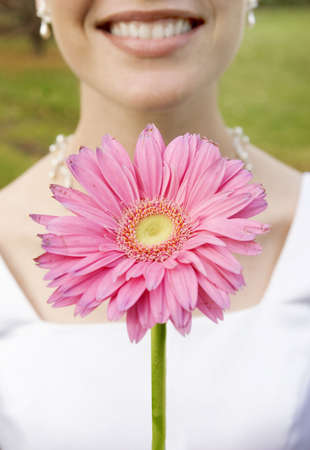 bride with pink flower photo
