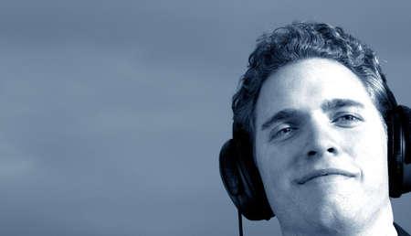 Business man is smiling with very large set of headphones photo