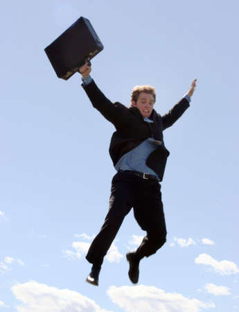 understands: Businessman finally understands that success requires risks, and so he leaps as he holds onto his briefcase