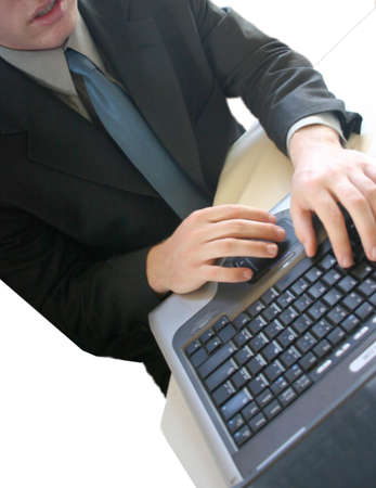 Business Man working on his laptop in the office