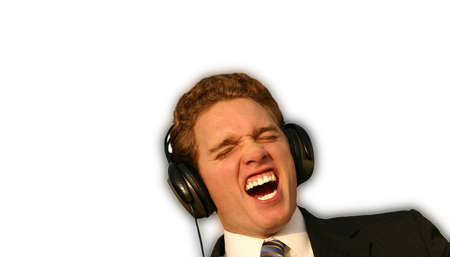 Businessman is rocking out to his favorite tunes on his very large headphones