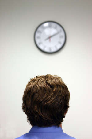 no rush: Businessman stares at the clock Stock Photo