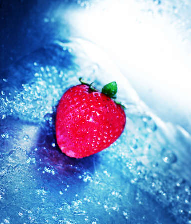 fortifying: Rushing, blue water with fresh, red strawberry Stock Photo