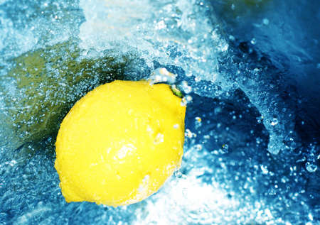 energizing: Yellow lemon in rushing, clear, blue water