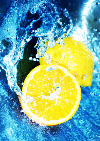 fortifying: Yellow lemons in clear, blue, rushing water