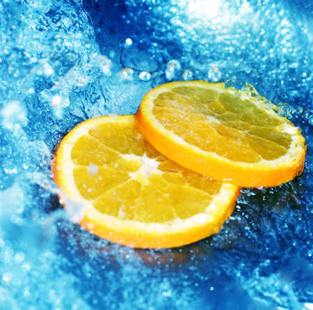 fortifying: Blue, clear water rushing with cut oranges