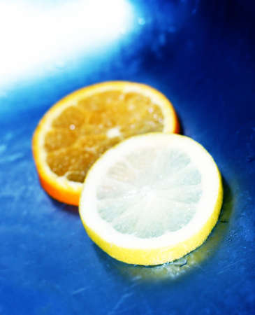 fortifying: lemon and orange slices in blue water