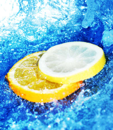 fortifying: Lemon and orange slices in blue, rushing water