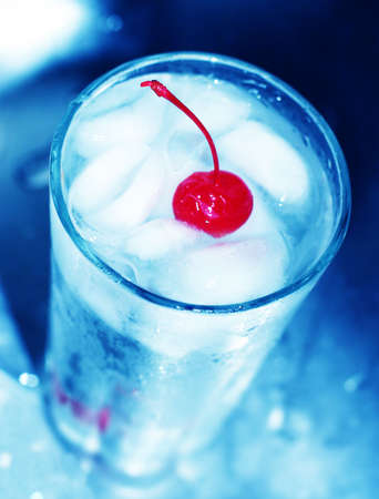 fortifying: Red cherry in cool, refreshing glass of water with ice