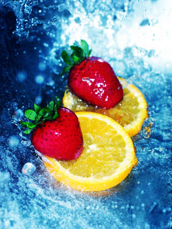 fortifying: Red, ripe strawberries on cool orange slices in refreshing water