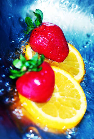 fortifying: Red, ripe strawberries on orange slices in cool, refreshing water