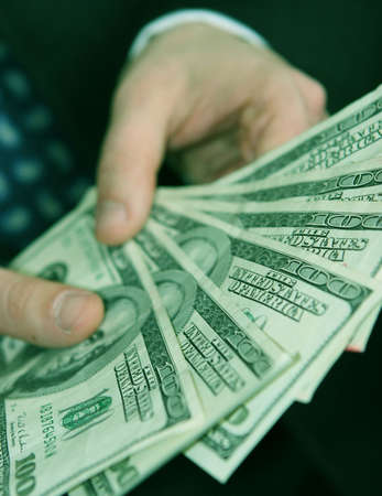 Businessman counts his money and his one hundred dollar bills in his hands Stock Photo - 590193