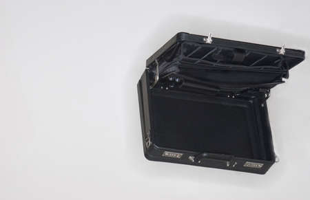 A black rectangular briefcase is open against a white background