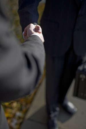 Two businessmen shaking hands  Imagens