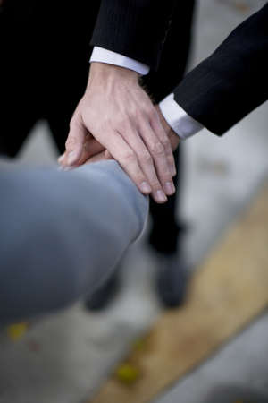 close up view of three peoples' hands on top of each other in business situation  Stock Photo - 1998009