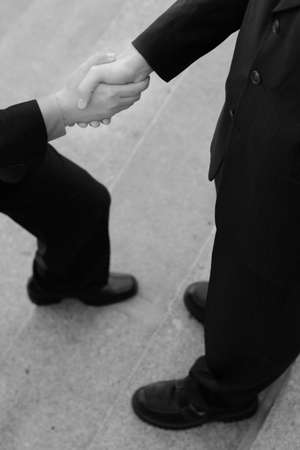 stepping: Businessman Gives a Handshake while hes stepping forward
