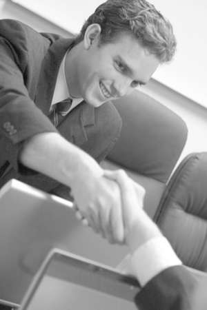 close up of two business people shaking hands photo