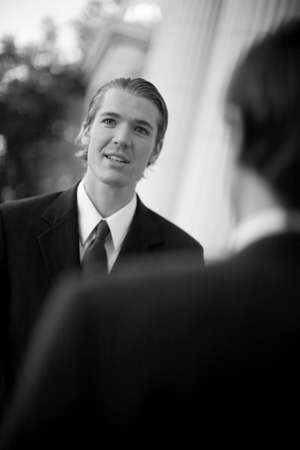over the shoulder view: over shoulder view of businessman standing in suit and tie Stock Photo