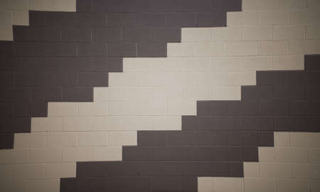 a pattern on the brick wall with a repeating brown and tan pattern  Imagens