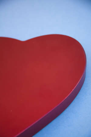 a close-up of a red heart shaped symbol on a blue background